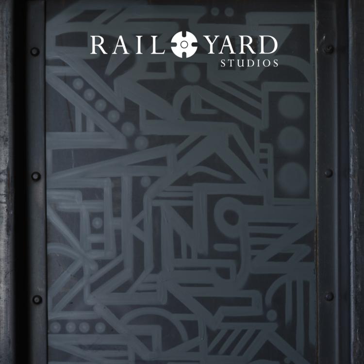 graffiti artist monochromatic public art gray rail yard studios